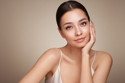 Fototapeta Portrait beautiful young woman with clean fresh skin. Model with healthy skin, close up portrait. Cosmetology, beauty and spa