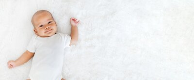 Fototapeta Portrait newborn baby happy over white background, topview