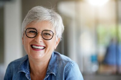 Fototapeta portrait of a beautiful smiling 55 year old woman with white hair
