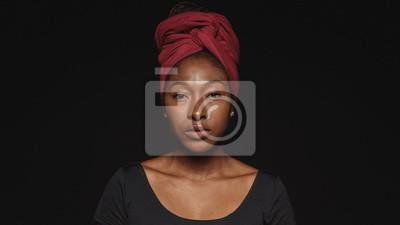 Fototapeta Portrait of an african woman in a headwrap