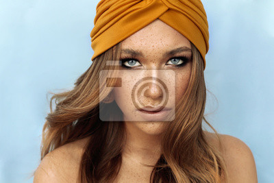 Fototapeta portrait of beautiful young woman with brown hair and freckles face