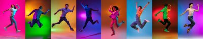 Fototapeta Portrait of group of people jumping isolated on multicolored background in neon light, collage.