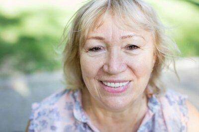 Fototapeta Portrait of happy mature woman outdoors