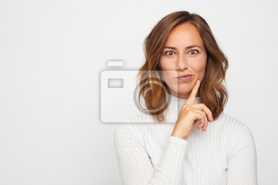 portrait of happy young woman looking funny in camera