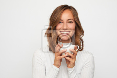 portrait of happy young woman with cup of coffee