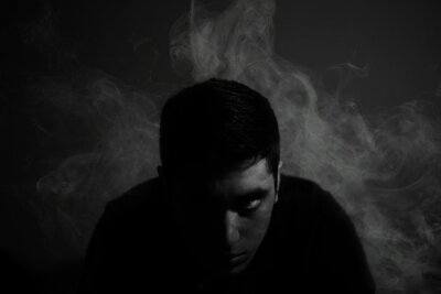 Fototapeta Portrait Of Man Surrounded By Smoke