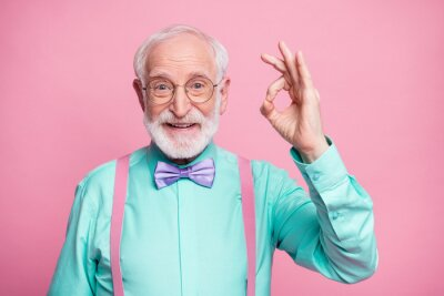 Fototapeta Portrait of positive cheerful old gentleman show okay sign decide choose perfect ads decisions choice wear good look outfit purple bow tie isolated over pastel color background