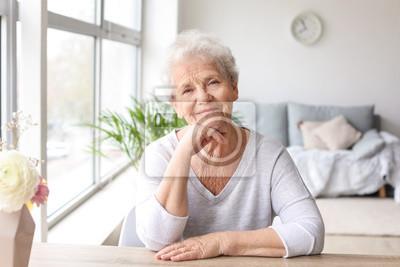Fototapeta Portrait of senior woman at home