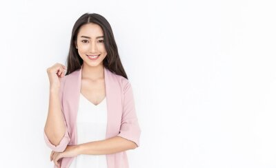 Fototapeta Portrait of smiling confident asian business woman in pink suit office. Asian business girl. Startup successful power business leader executive people looking camera with copy space isolated on white