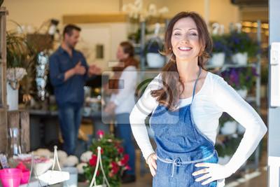 Fototapeta Portrait Of Smiling Female Owner At Flower Shop