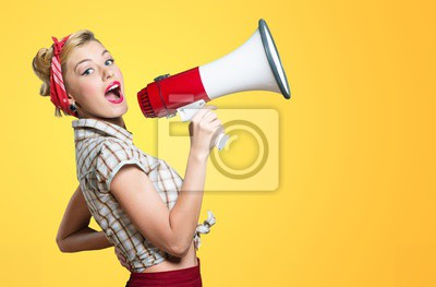 Fototapeta Portrait of woman holding megaphone, dressed in pin-up style