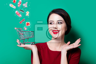portrait-of-young-happy-woman-with-shopping-basket-on-green-background-400-117117635.jpg
