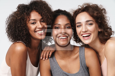Fototapeta Portrait of young multiracial women standing together and smiling