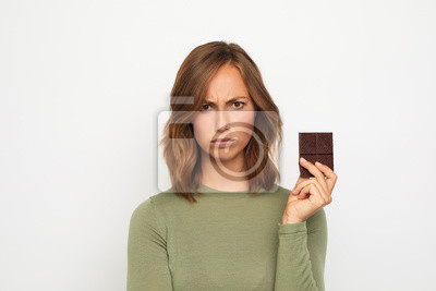 portrait of young woman with chocolate mad and sad