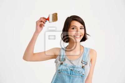 Portret młodej kobiety piękne dziewczynka, trzymając malowanie bru