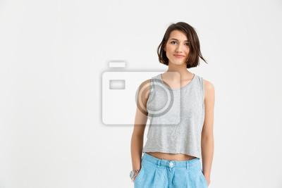 Portret młodej pięknej dziewczyny uśmiechnięte, trzymając się za ręce w PKOl