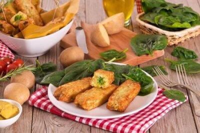 Fototapeta Potato croquettes with spinach and mozzarella.