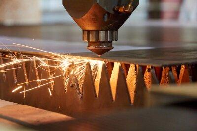 Fototapeta precision laser cutting of steel sheets on a cnc laser machine
