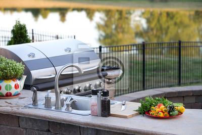 Fototapeta Preparing a healthy meal in an outdoor kitchen