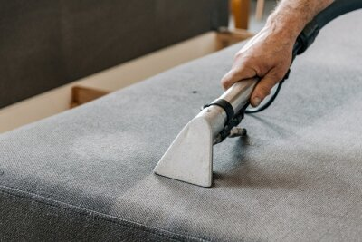 Fototapeta Professional cleaning service deep cleaning sofa at home.