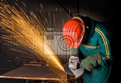 Fototapeta Przemysł ciężki robotnik szlifierka w tle