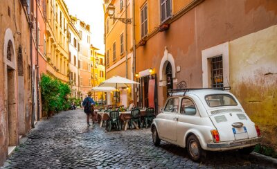 Fototapeta Przytulna ulica w Trastevere, Rzym, Europa. Trastevere to romantyczna dzielnica Rzymu, wzdłuż Tybru w Rzymie. Turystyczne przyciąganie Rzymu.