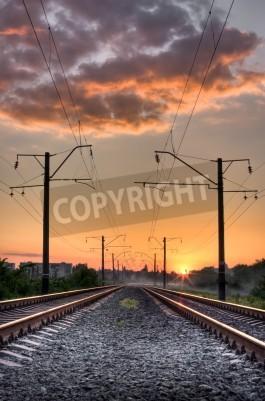 Fototapeta Railway way on sunset of a sun