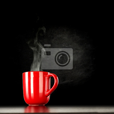 Red mug on black background of free space