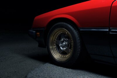Fototapeta red old racing car on stylish titanium rims