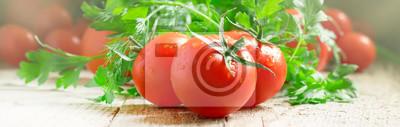 Fototapeta Red tomatoes and green herbs, close up, macro shot, banner, selective focus