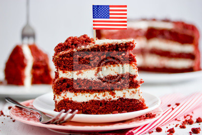 Fototapeta Red velvet cake, classic three layered cake from red butter sponge cakes with cream cheese frosting, American cuisine