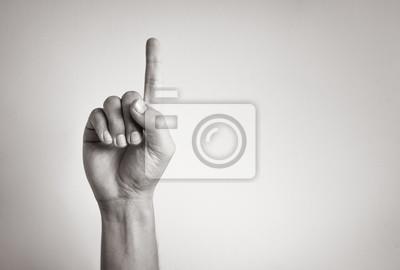 Fototapeta Ręka pokazuje jeden palec.