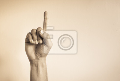 Fototapeta Ręka trzyma jeden palec wskazujący.
