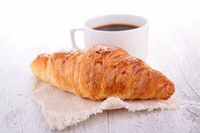 Fototapeta rogalik i filiżanka kawy