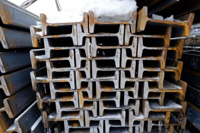 Fototapeta rolled metal lies on the street under the snow