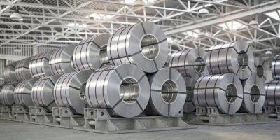 Fototapeta Rolls of metal sheet. Zinc, aluminium or steel sheet rolls on warehouse in factory.