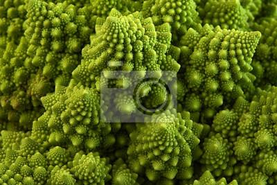 Fototapeta Romanesco broccoli or Roman cauliflower, close up shot from above, texture detail of the healthy vegetable Brassica oleracea, a variation of cauliflower. macro photo