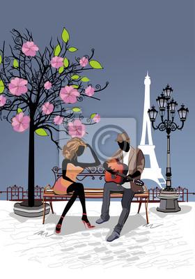 Romantyczna para z gitara siedzi na ławce