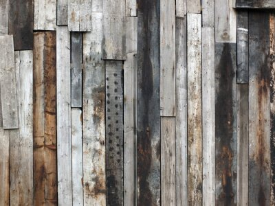 Fototapeta Rough Textured Timber Wall Made Of Stained Mismatched Recycled Old Planks