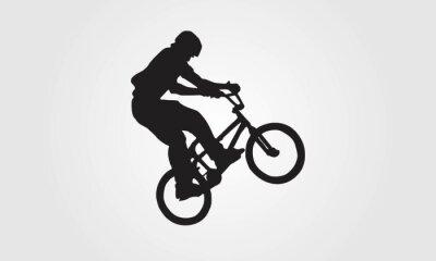 Fototapeta Rowerzysta jeździec bmx wykonuje trik skok sylwetka wektor logo