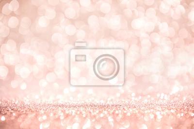 Fototapeta Różowe złoto i różowy brokat, niewyraźne streszczenie święta światła na tle.