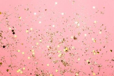 Fototapeta Różowy świąteczny confetti tło. Jasne tło na obchody urodzin.