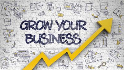 Fototapeta Rozwijaj swój biznes na białej ścianie.