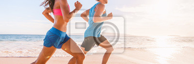 Fototapeta Run fit people running on beach with healthy toned legs body, Hamstring muscles, knee joint health active lifestyle panoramic banner background.