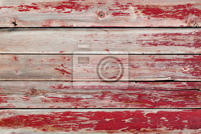 Fototapeta Rustic old weathered wood background of planks with peeling red paint