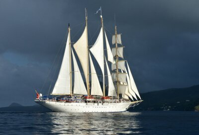Fototapeta Sailing ship on the background of a stormy sky