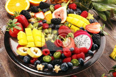 salad with fresh fruits and berries. healthy spring fruit salad  with strawberries