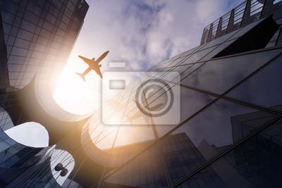 Fototapeta samolot nad budynkami gródów
