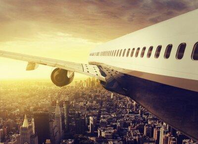 Fototapeta Samolot nad wielkim mieście