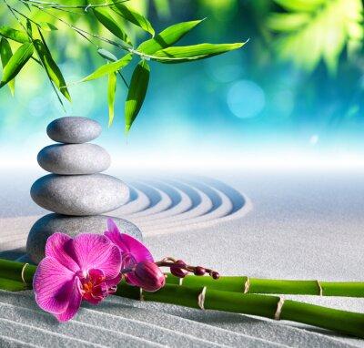 Fototapeta sand, orchid and massage stones in zen garden